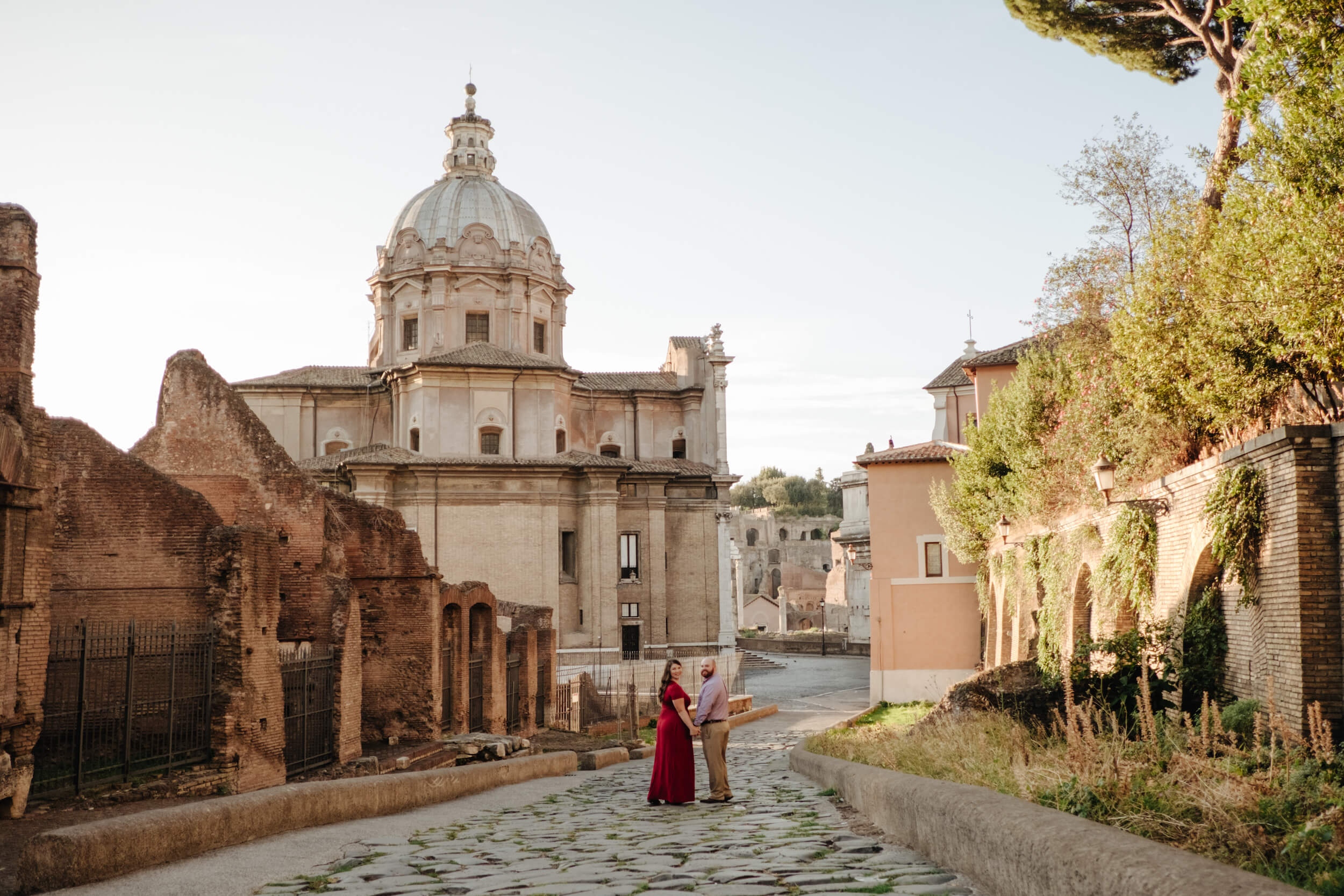 Romantic couple walking in along the streets of Rome on a Flytographer photoshoot
