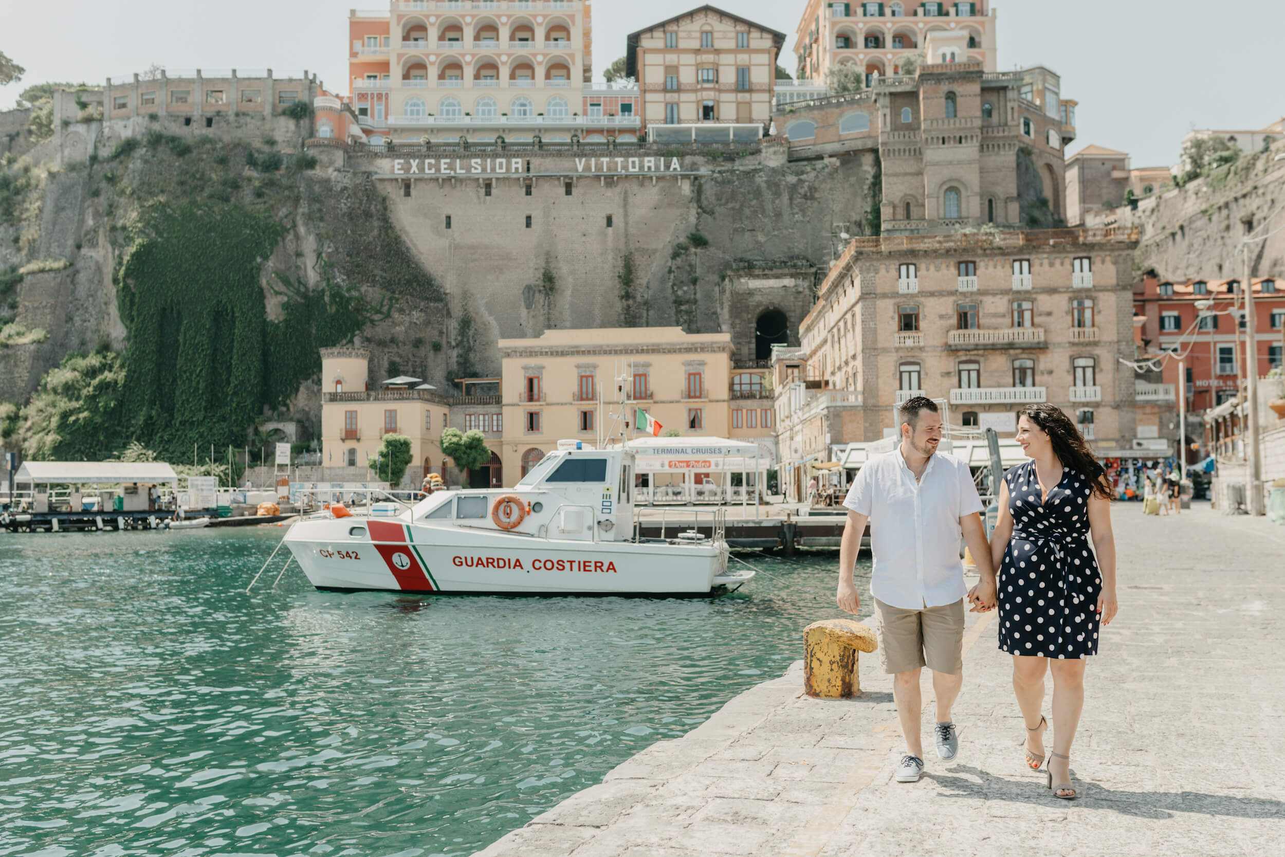 Romantic couple walking on the pier in Sorrento, Italy on a Flytographer photoshoot