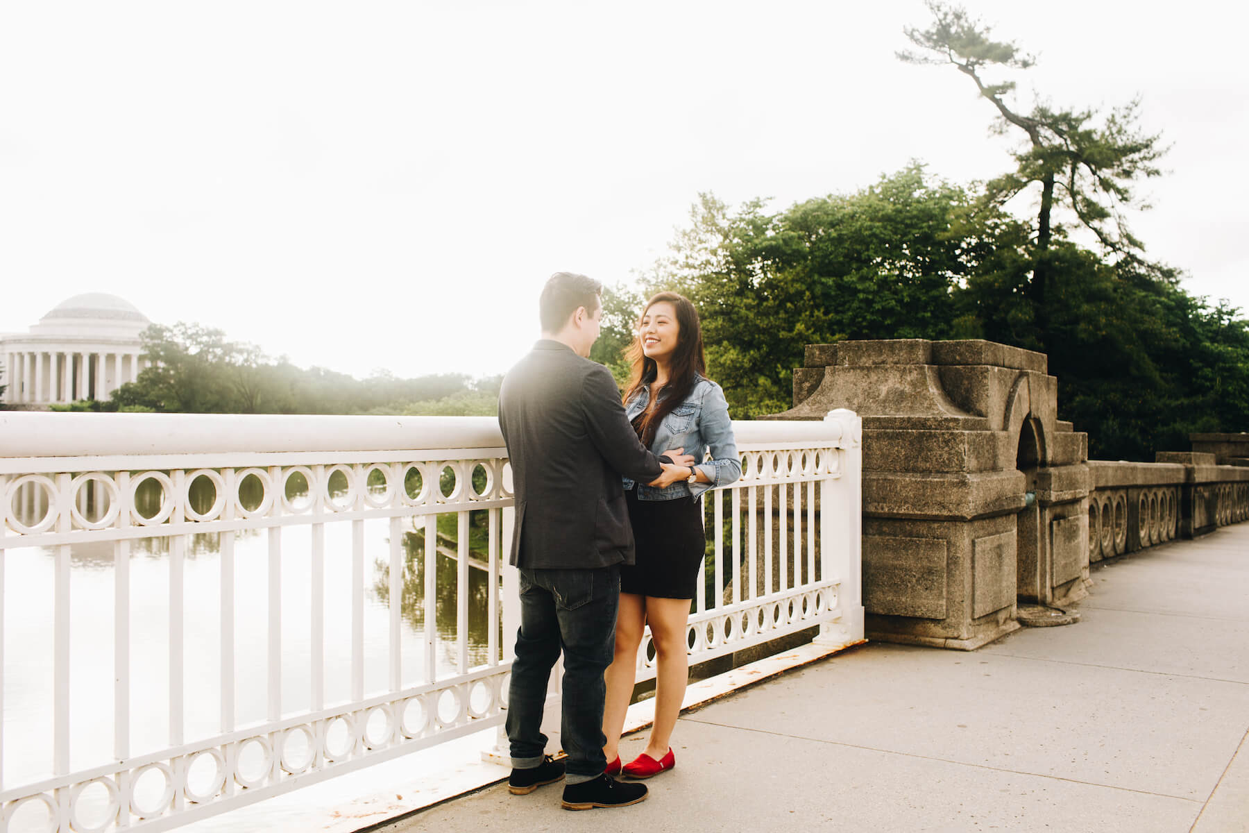 Couple walking inside the Lincoln Memorial in Washington DC on a couple photoshoot with Flytographer.