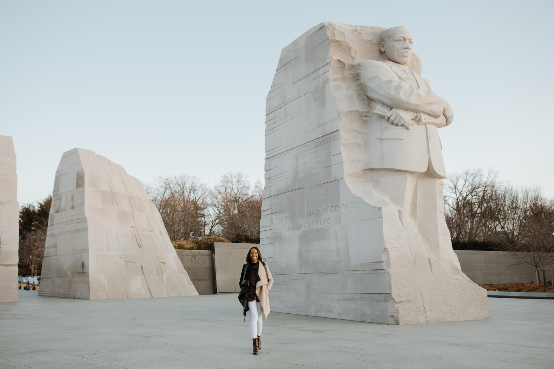 Woman walking at the Lincoln Memorial in Washington DC on a modern headshot photoshoot with Flytographer.