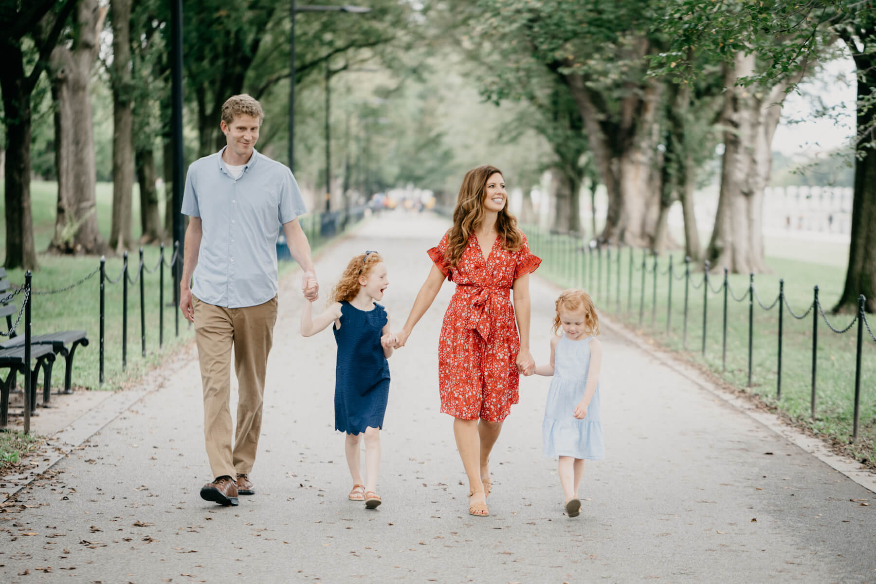 Family walking at the Lincoln Memorial in Washington DC on a family photoshoot with Flytographer.