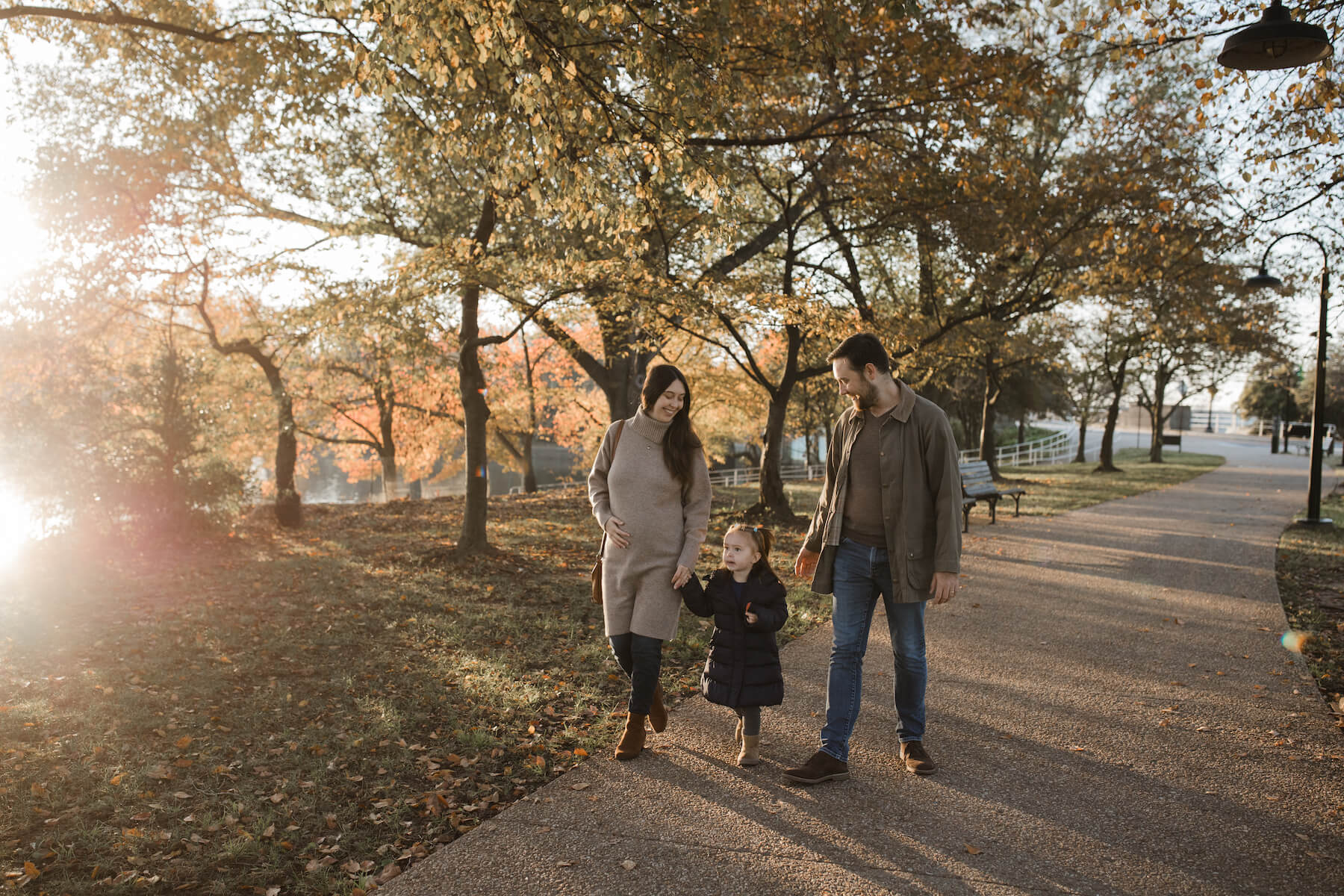 Family posing at the tidal basin in Washington DC on a family photoshoot with Flytographer.