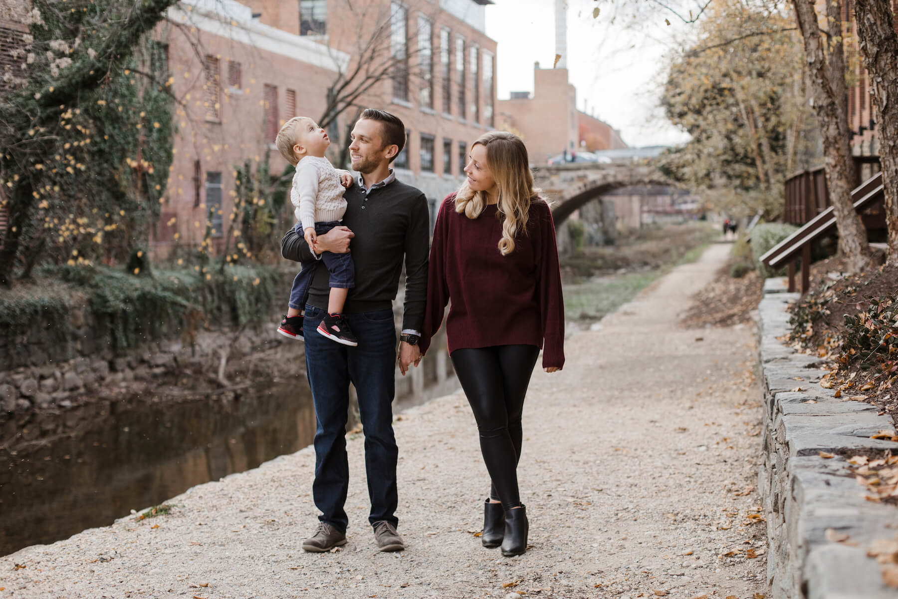 Family posing at the canal Washington DC on a family photoshoot with Flytographer.