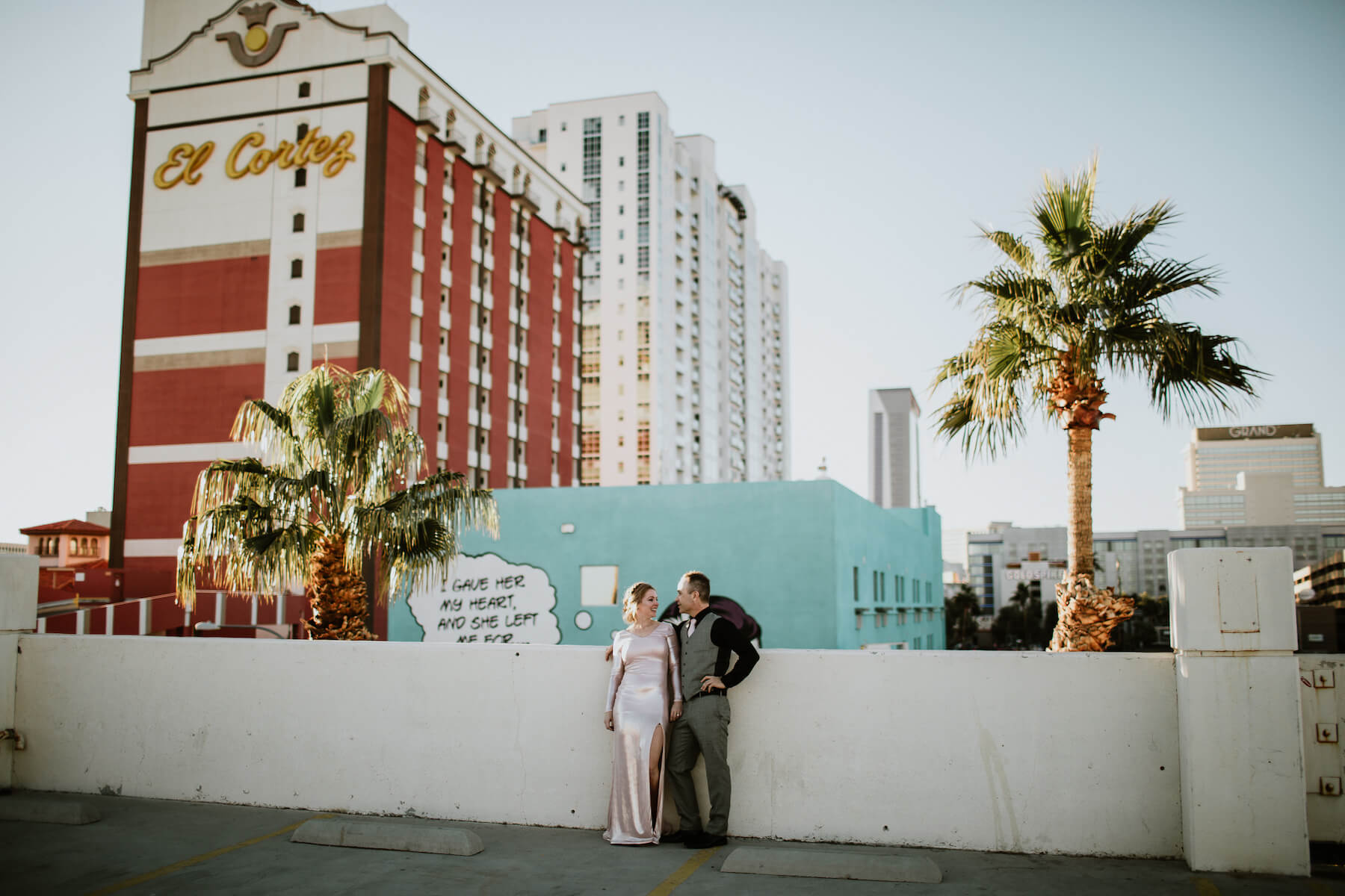 A couple dressed up are hugging in Las Vegas on a couple shoot with Flytographer to celebrate their wedding.