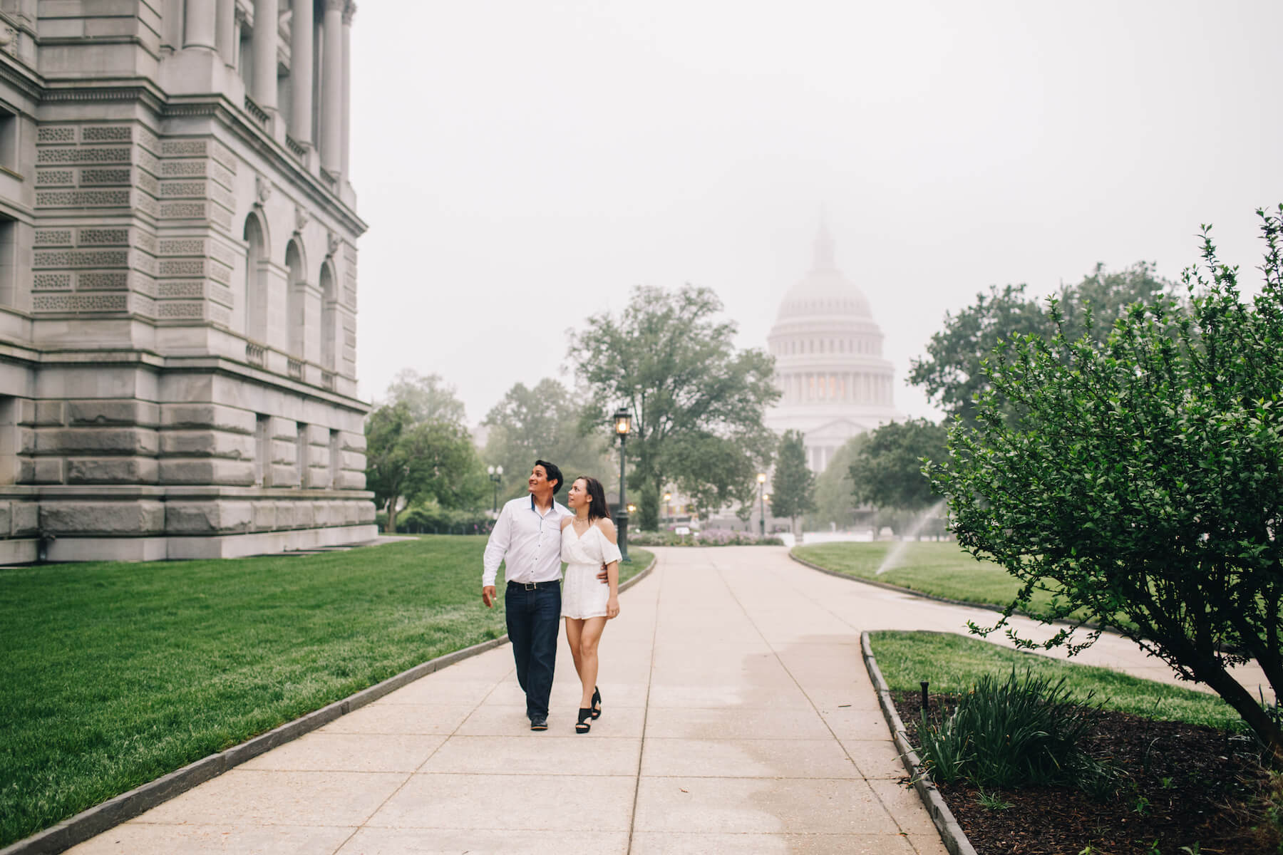 A couple walking at the Library of Congress in Washington DC on a couple photoshoot with Flytographer.